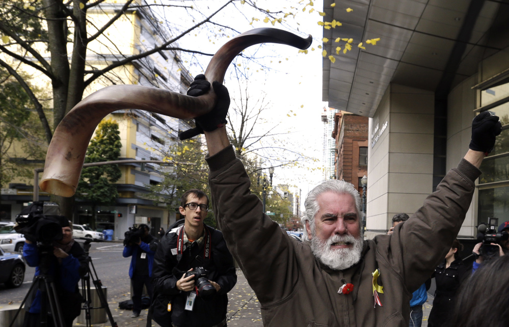 Brand Thornton celebrates outside the courthouse after hearing that the seven defendants were exonerated on conspiracy charges stemming from the Oregon standoff.