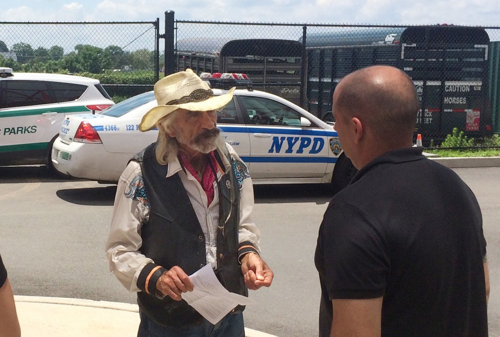 """Tod """"Doc"""" Mishler, seeks the return of his horses in Staten Island, N.Y. The 80-year-old cowboy was arrested in June on animal cruelty charges after investigators concluded his horses were malnourished and is suing the city for the return of his horses. (Anthony DePrimo/Staten Island Advance via AP)"""