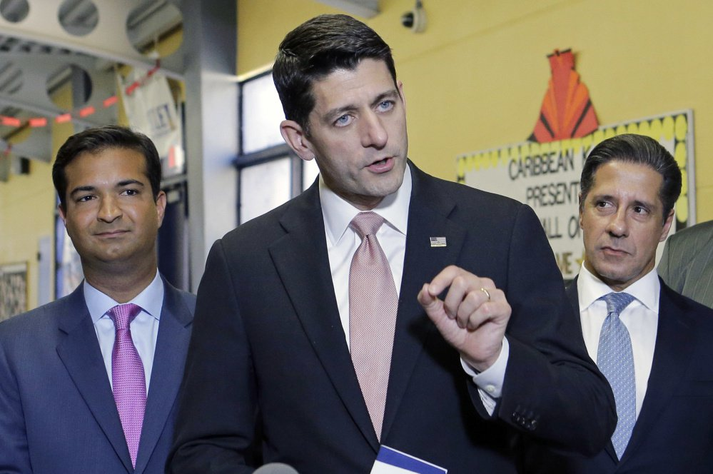 House Speaker Paul Ryan speaks as Rep. Carlos Curbelo, R-Fla., left, and Alberto Carvalho, superintendent of Miami-Dade County Public Schools, listen on Oct. 19 in Miami.