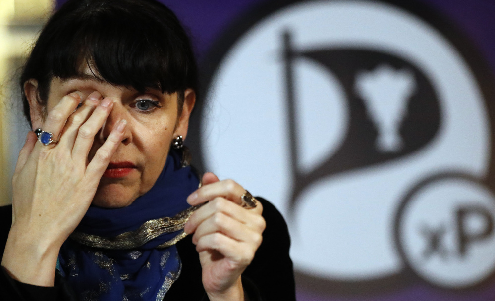 Birgitta Jonsdottir of the Pirate Party addresses the media during a news conference in Reykjavik, Iceland, on Sunday after the national elections.