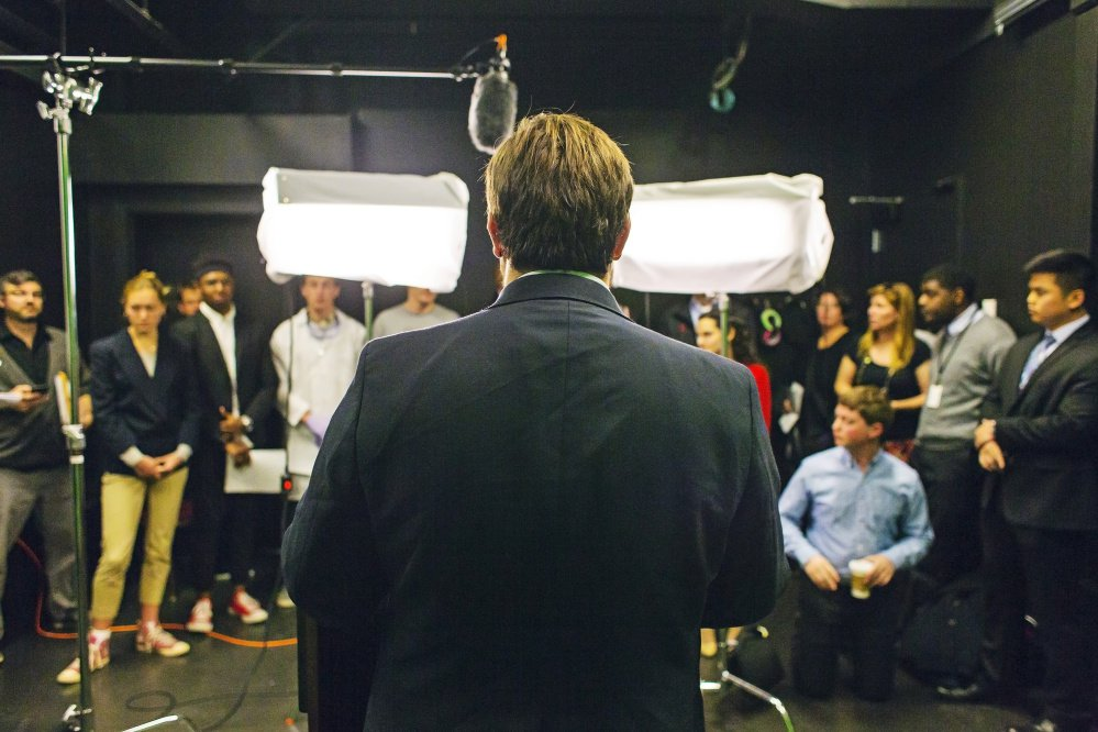 Student Gabriel Nott, playing the part of a presidential candidate, fields questions after making a mock televised address about a national crisis. More than a dozen classes on campus are assigned some task tied to the campaign exercise.