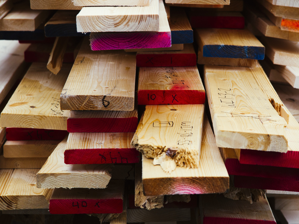 The University of Maine's Advanced Structures and Composites Center's collection of broken pieces of Norway spruce lumber, used in testing the suitability of the wood as building material.