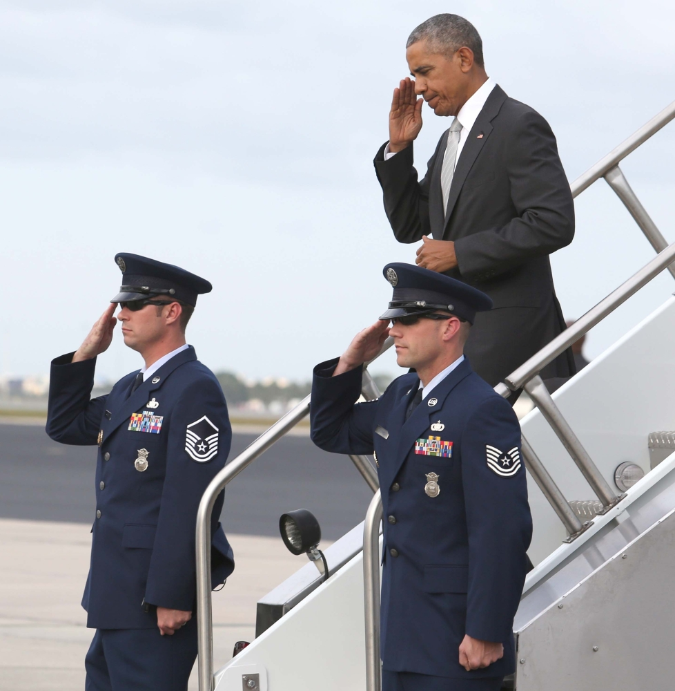 Joe Burbank/Orlando Sentinel President Obama returns a salute Friday as he arrives at Orlando International Airport for a rally for the Hillary Clinton campaign at the University of Central Florida.