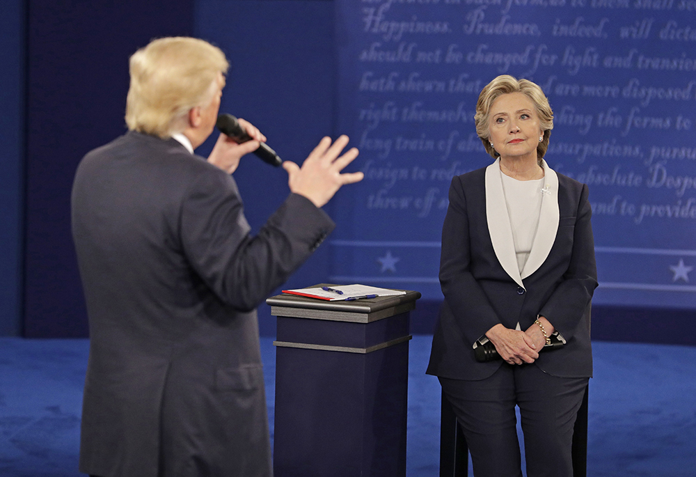 Hillary Clinton listens to  Donald Trump during the second presidential debate on Oct. 9, 2016,  in St. Louis. National polls have moved in Clinton's direction since the exchanges began in late September. <em>Associated Press/John Locher</em>