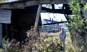 Michael Sholz stands in an old barn Wednesday at his Albion Bread Farm on East Benton Road in Albion. Sholz chose to conserve the crop and forest land with the Sebasticook Regional Land Trust in 2010.