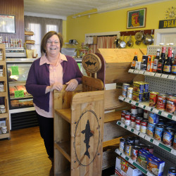 Ruth LaChance on Thursday at her downtown Hallowell business, Boynton's Market, one of the businesses concerned about the potential effect of retail development outside of downtown.