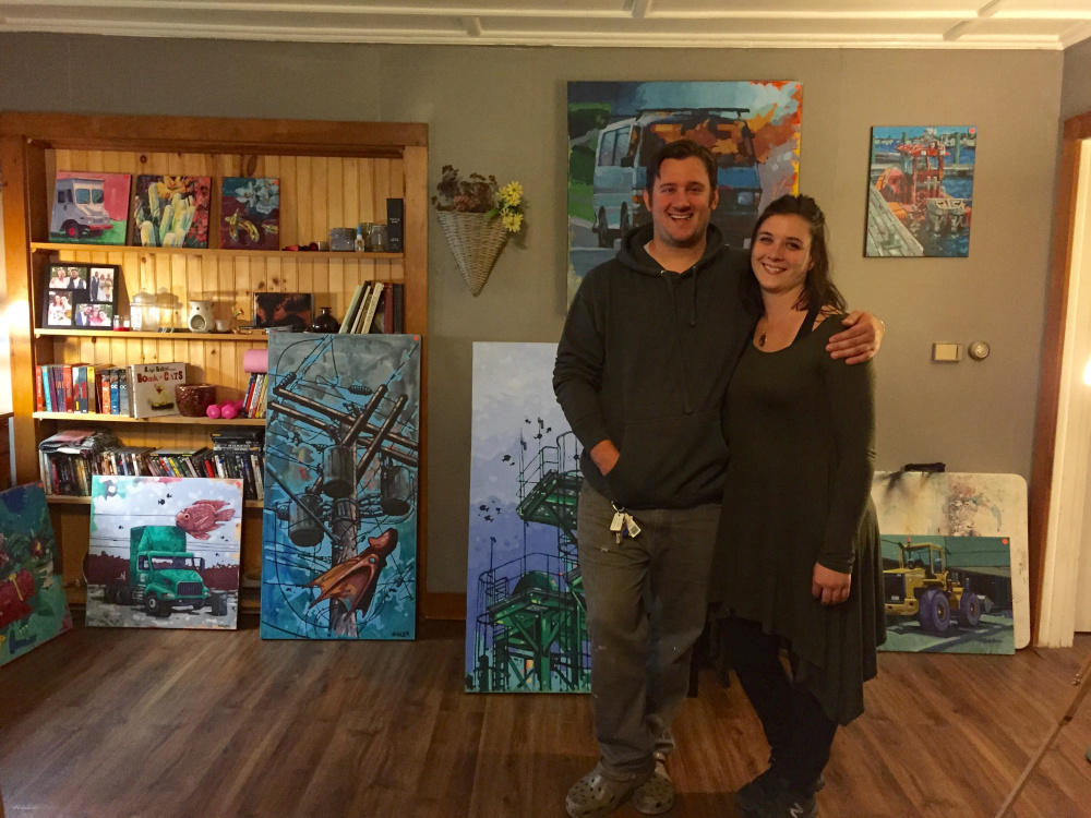 Artists Ryan Kohler and Danielle Harker opened their home Saturday in Skowhegan as part of the Wesserunsett Arts Council's seventh annual Open Studio Tour. The couple are seen standing in front of selections of Kolher's oil paintings.