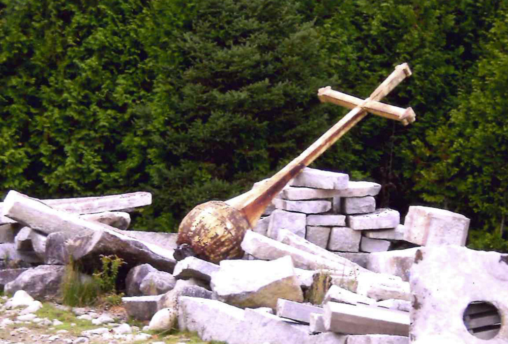 The cross that was atop the steeple of the former St. Francis de Sales Catholic Church on Elm Street in Waterville was left in a pasture in Albion, shown here, after the church was torn down in 2013. Pearley Lachance of Winslow learned where the cross had been left, rescued it from the field, is paying to have it restored, and plans to have it erected in St. Francis Catholic Cemetery off Grove Street in Waterville.