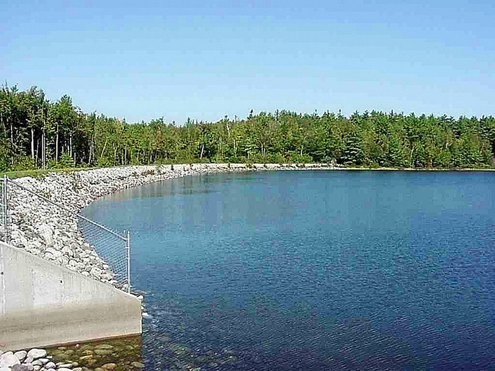 This September 1999 handout photo shows the south shore and spillway at Carleton Pond. Officials are considering the formation of a new group that would write regulations to allow some access to the pond.