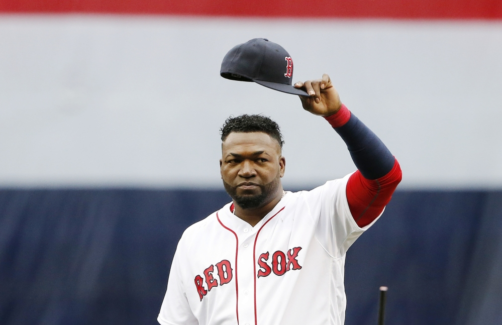 Boston's David Ortiz tips his cap to the crowd during ceremonies before a game against the Toronto Blue Jays on Sunday in Boston.
