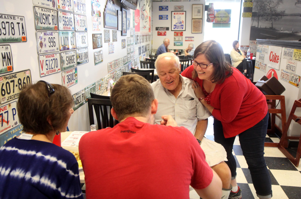 Democrat Emily Cain gives supporter David McVety of Otisfield a hug at Daddy O's Diner on Route 26 in Oxford while campaigning Aug. 26 in Oxford County. Looking on is McVety's wife, Linda and son, Rob.