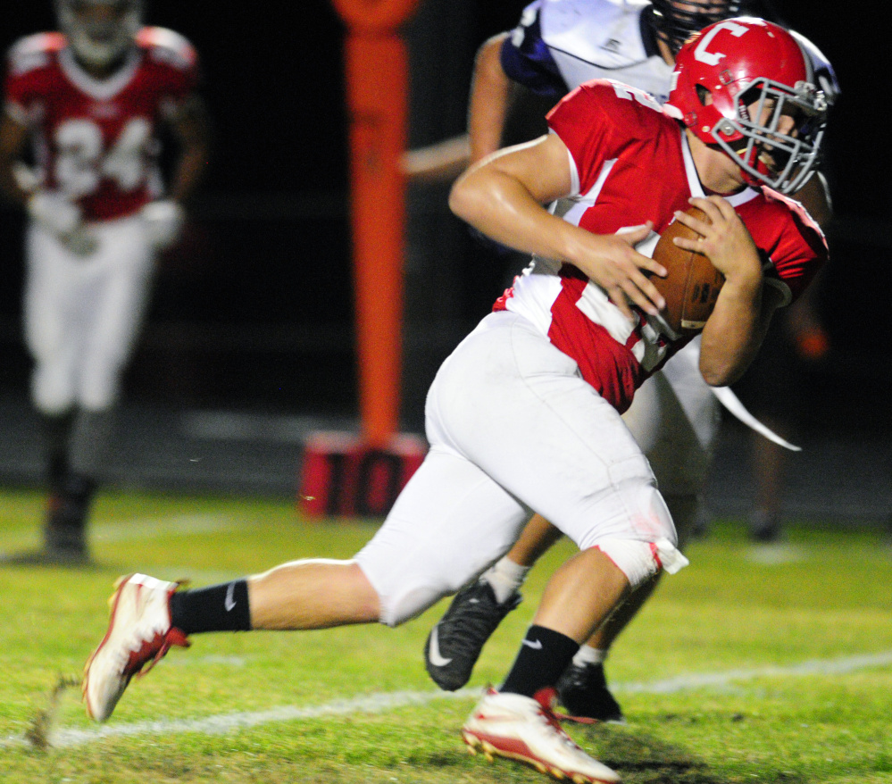 Cony's Chad Bickford runs the ball against Hampden during a Pine Tree Conference B game Friday in Augusta.