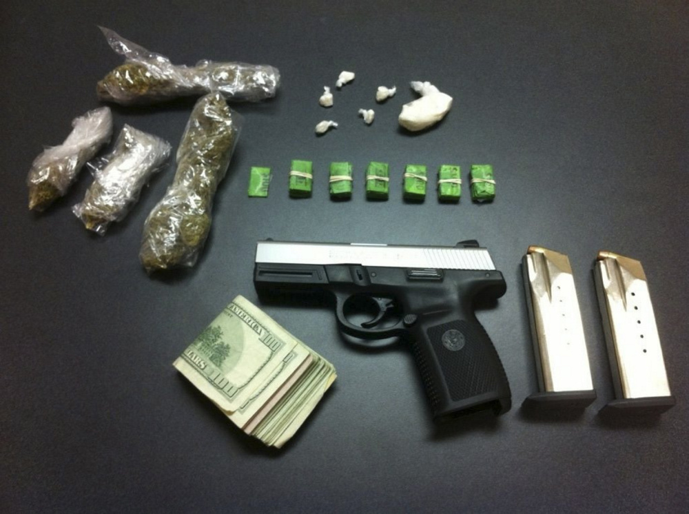 Two people face charges of trafficking in crack cocaine and heroin following their arrest in a Congress Street parking lot Wednesday night. Police seized a half-ounce of crack, 61 bags of heroin and $1,600. Police also found a loaded .40 caliber handgun in the glove box of the couple's car. The couple was arrested at the 1100 block of Congress Street near the intersection with Park Avenue.