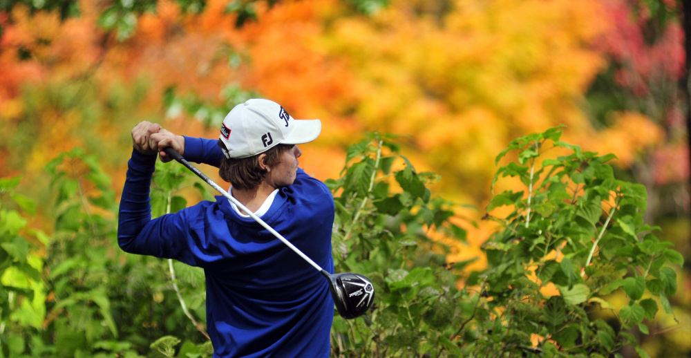 Staff photo by Joe Phelan   Erskine Academy golfer Connor Paine tees off on Arrowhead's 18th hole during the state team championship Saturday at Natanis Golf Course in Vassalboro.