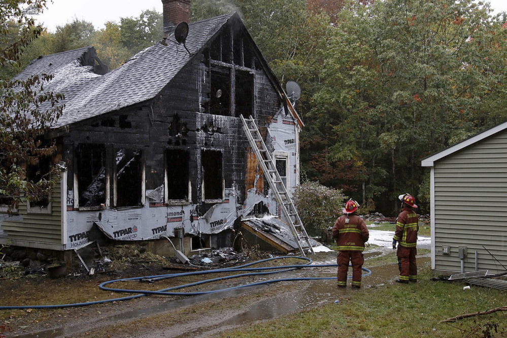 Firefighters battle a fire Sunday at 116 Pleasant Cove Road in Boothbay. Two people died and four others were injured. Joel Page/Staff Photographer
