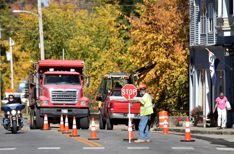 Construction crews work on the sidewalks on Main Street in downtown Wilton on Friday.