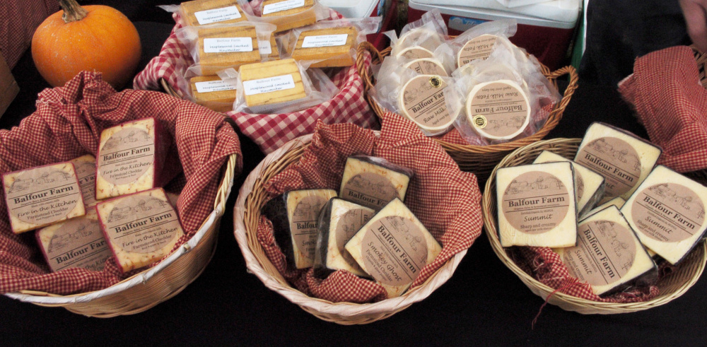 Cheeses made at the Balfour farm in Pittsfield await farm visitors during Open Creamery Day on Sunday.