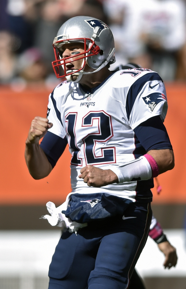 New England Patriots quarterback Tom Brady celebrates a touchdown in the first half against the Cleveland Browns on Sunday in Cleveland.