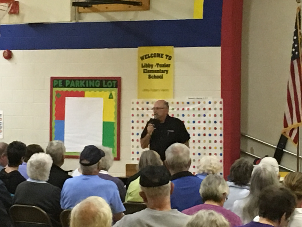 Mark Russell, chairman of the Litchfield Select Board, explains the difference between two proposed recall ordinances up for a vote at a special town meeting Tuesday night in Litchfield.