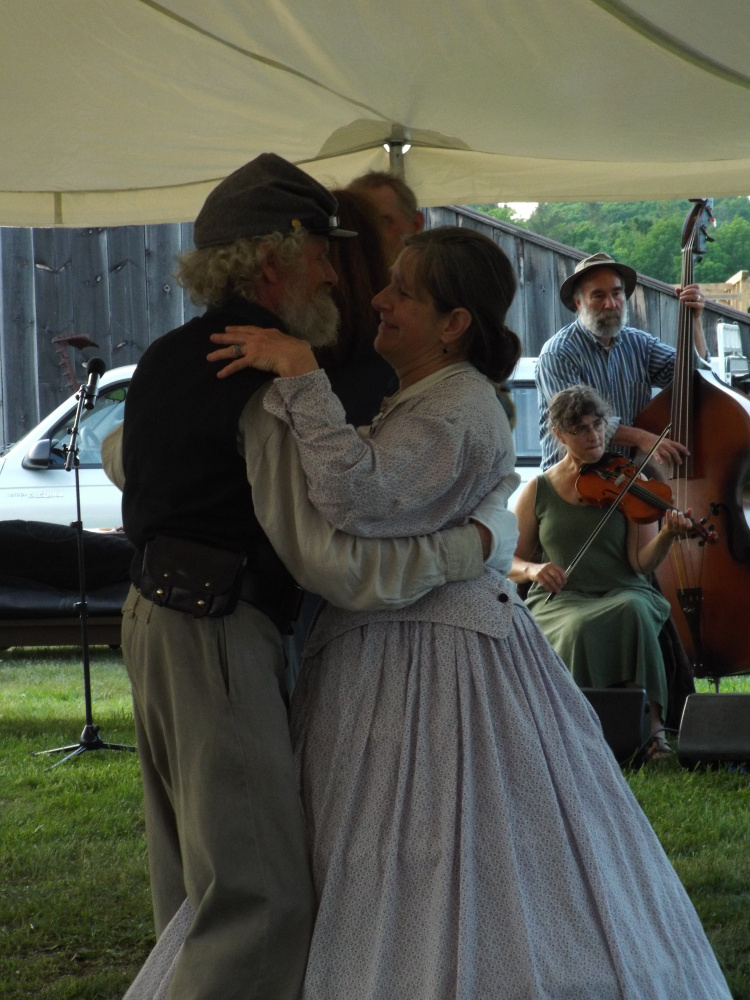 Tom Bassford and Sandra Swatsky dance to the tunes of the Racket Factory during the Rally for Norlands Civil War Reenactment in 2016.