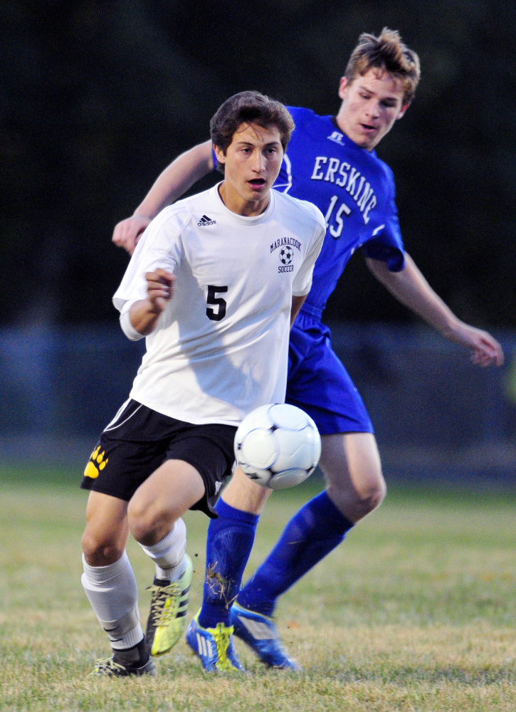 Maranacook's Jackson McPhedran, left, tries to get past Erskine's Christopher Weymouth during a game Tuesday at the Ricky Gibson Field of Dreams in Readfield.