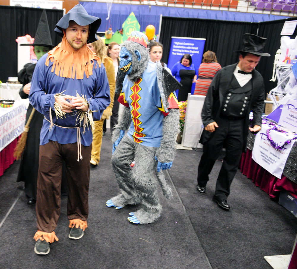 """Maine State Credit Union employees dressed as characters from the movie """"The Wizard of Oz"""" circulate among the booths Wednesday at the Kennebec Valley Chamber of Commerce EXPO on Wednesday at the Augusta Civic Center. Many people working at the show were in costume."""