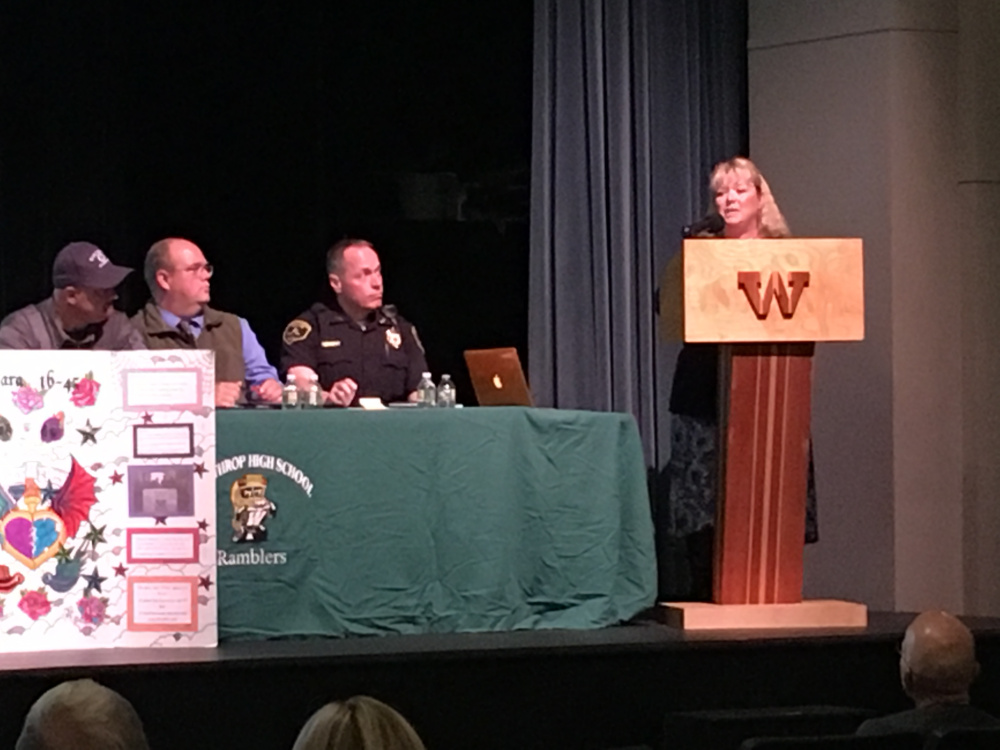 Donna Strickler, executive director of Sexual Assault Crisis & Support Center in Winthrop, addresses the approximately 60 people who attended a forum on opiate addiction at Winthrop High School.