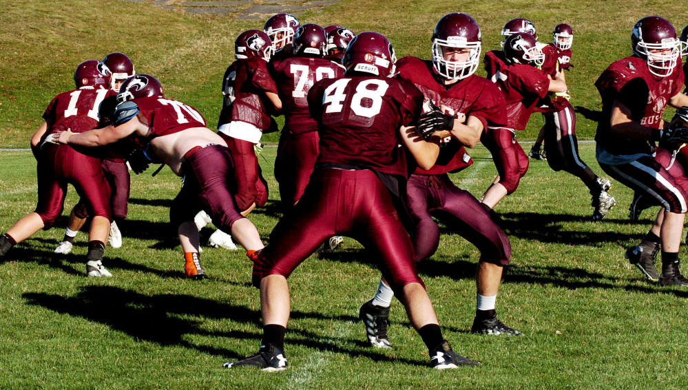 Members of the MCI offensive line work on blocking during a recent practice in Pittsfield.