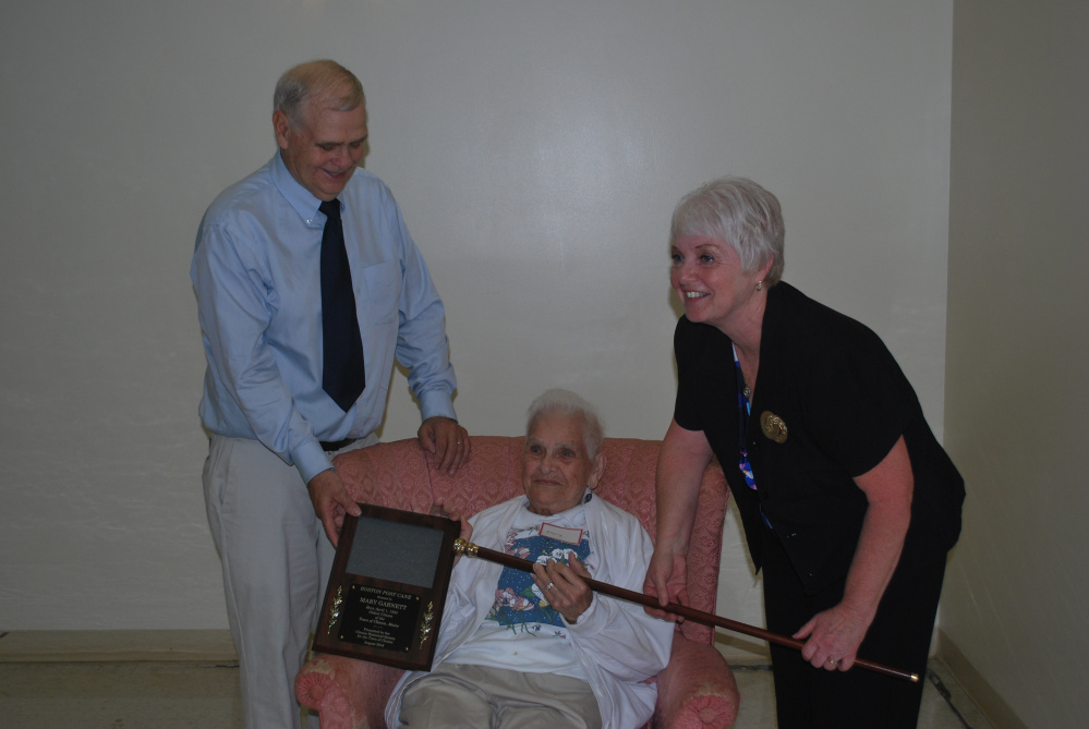 "The Boston Post Cane recently was presented to Mary Garnett, center, by Pam Violette, town manager of Clinton. Garnett also received a plaque from Clinton Historical Society President Blair ""Buddy"" Frost. At age 93, Garnett is the oldest resident of Clinton."