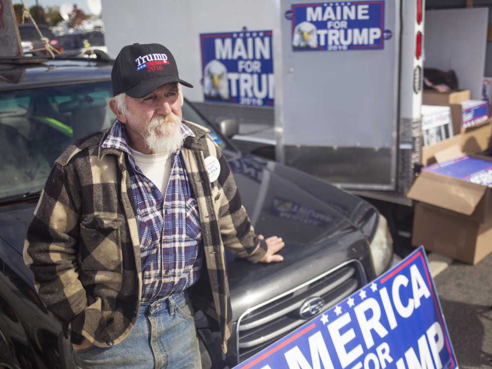 Steve Smith of Otter Creek, Maine, waits outside before the Donald Trump rally in Bangor on Saturday.