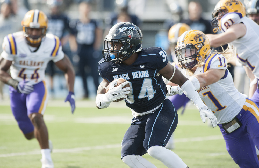 UMaine's  Josh Mack gains yardage against Albany during the first half Saturday in Orono. Photo by Kevin Bennett