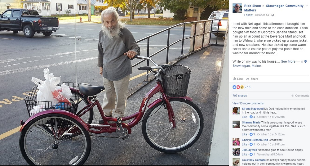 """Neil Woodard, the """"Bottle Man,"""" shows off his new trike Luca with a cargo of empties in the back basket."""