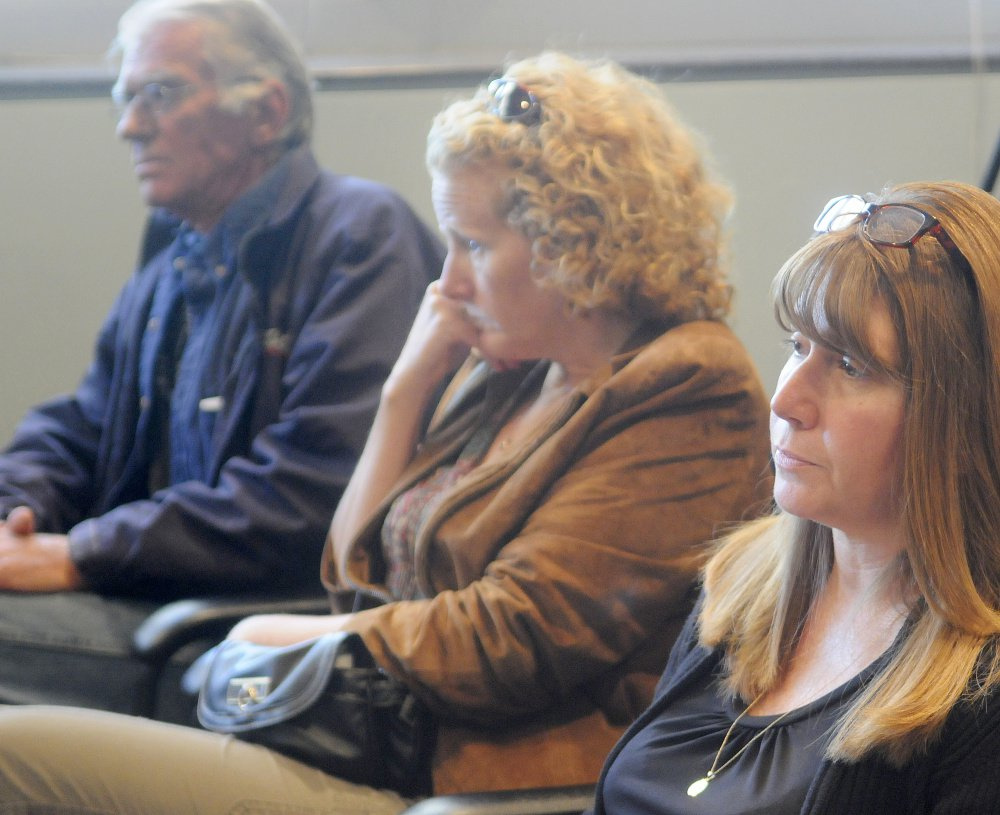 Friends and relatives of three people killed in a 1996 car crash listen to testimony Sept. 26 by Bryan Carrier at the Bureau of Motor Vehicles in Augusta. Relatives and friends of the victims are, from left, Royce Jewell and his partner, Tanya Morris, of Canaan; and Tracey Rotondi, of Athens.