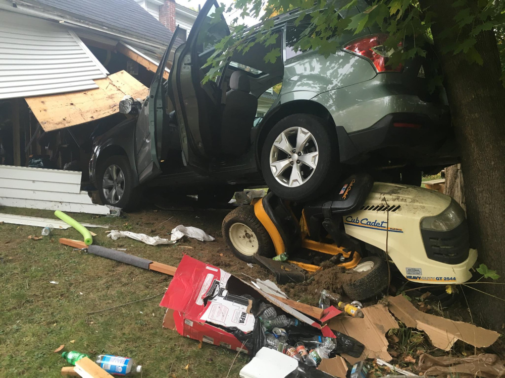 Patricia Amero, of Berry Road in Monmouth, backed her vehicle through the rear wall of a garage Tuesday afternoon but was not seriously injured in the accident.