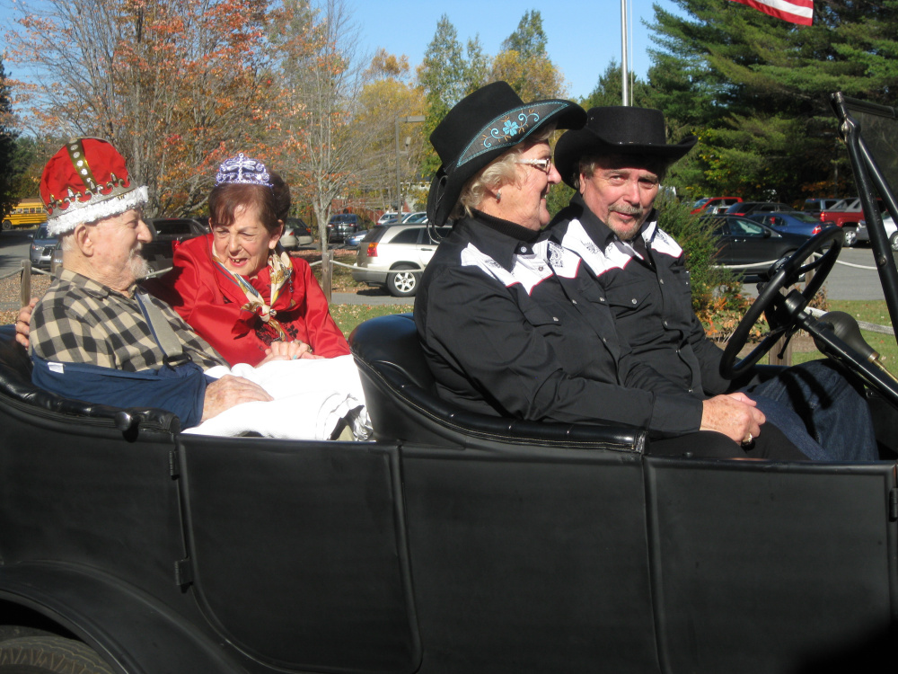David Sheila being driven in 1923 Model A Ford by David and Leah Mayo, of Anson.