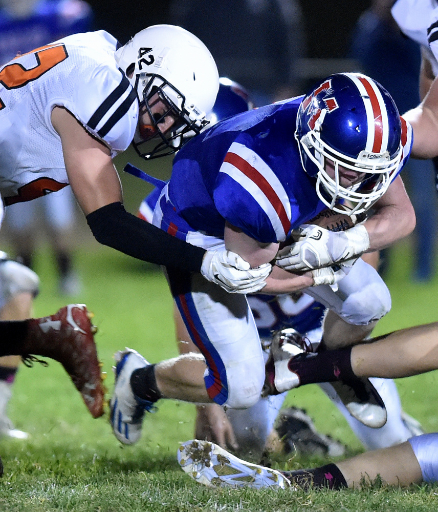 Messalonskee running back Austin Pelletier fights for a few extra yards during a game against Skowhegan earlier this season.