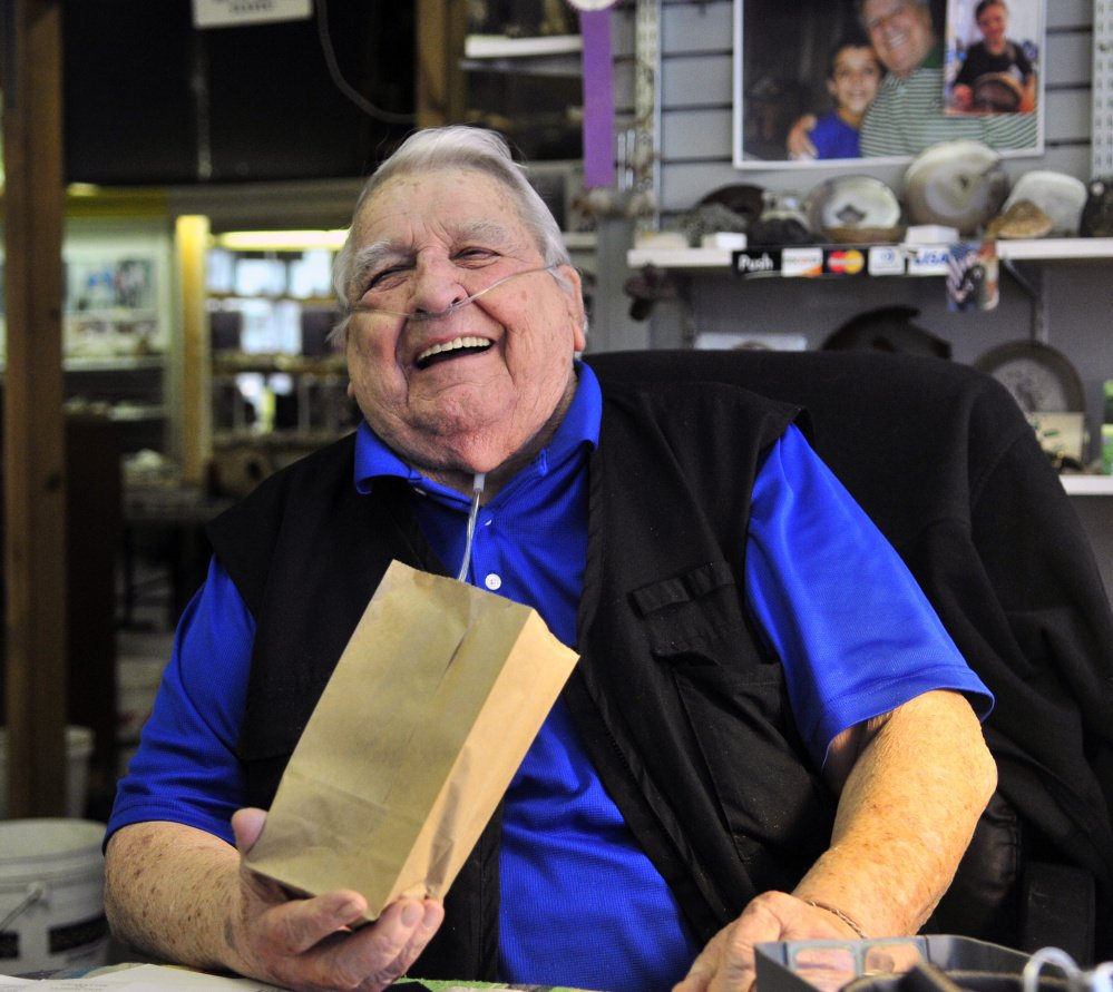 """Levi """"Sonny"""" Chavarie, who died Oct. 13 at age 91, laughs at something a customer said at his shop in Augusta in this 2015 file photo."""