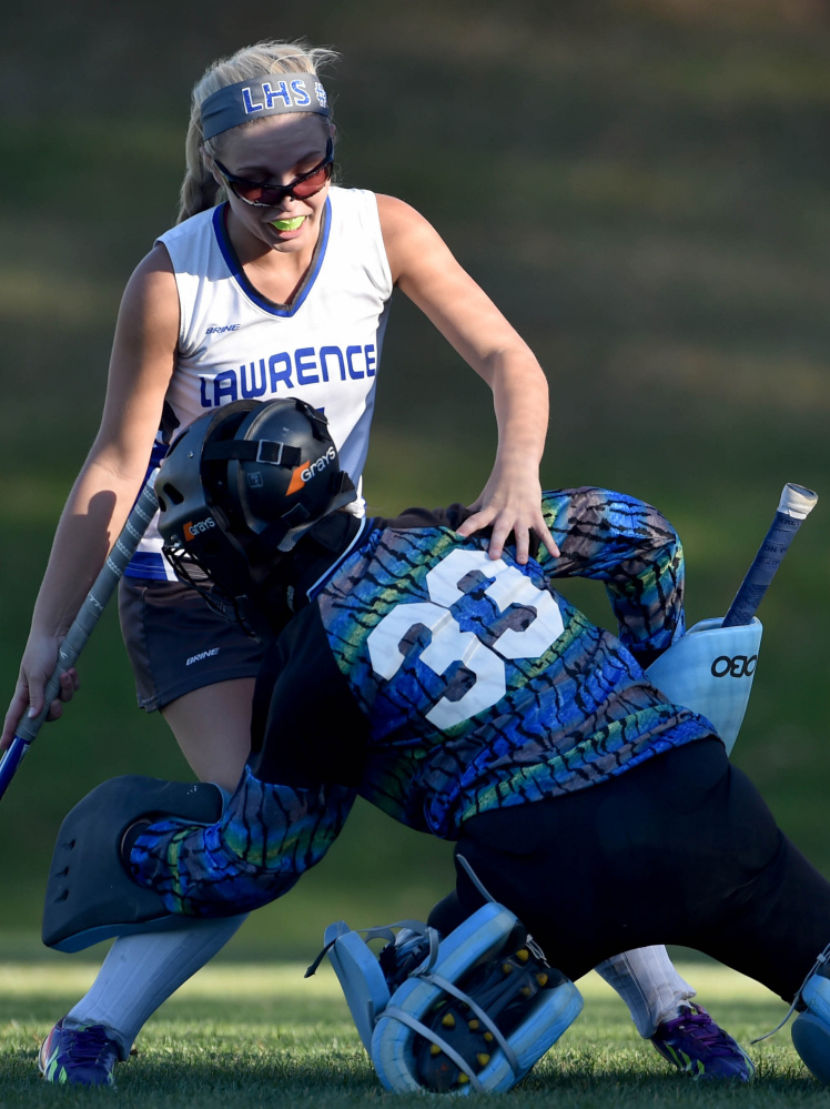 Lawrence senior forward Katelyn Gerow collides with Old Town goalie Corinne Saucier during a Class B North quarterfinal game last Wednesday in Fairfield. The Bulldogs edged top-seeded Foxcroft Academy 1-0 on Monday to reach the B North final on Wednesday.