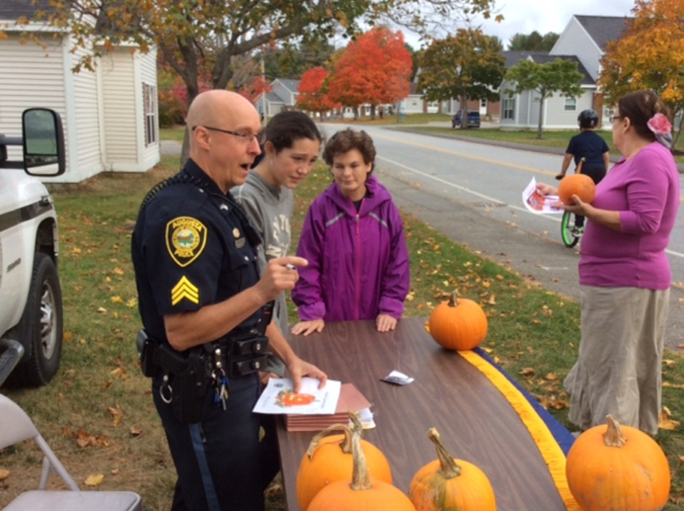 Sgt. Christian Behr keeps track of each Operation Pumpkin contest drawing submitted by Glenridge Drive school-age children in Augusta.