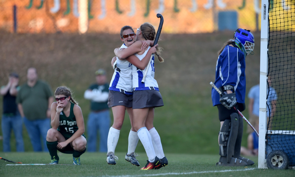 Lawrence sophomore Nora Buck, right, celebrates with Macie Larouche after Larouche scored in double overtime of a Class B North quarterfinal game against Old Town in Fairfield.