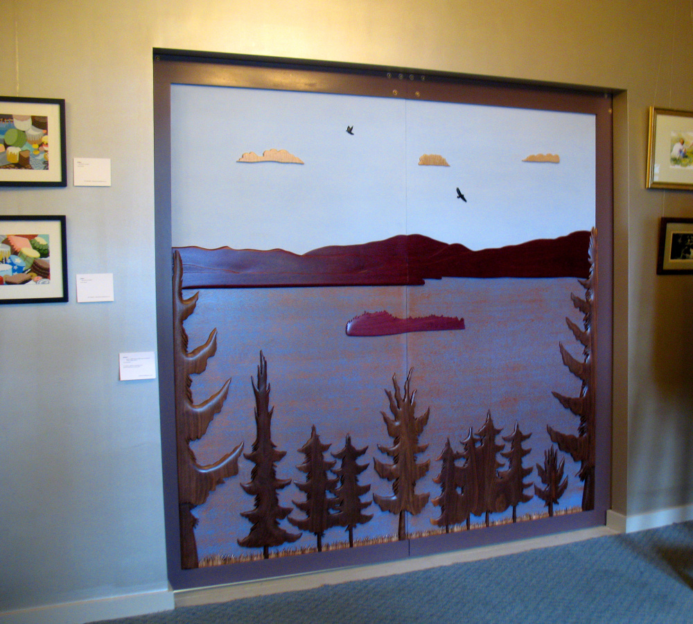 Artist Vincent Richel's finished doors adorn the New Lobby Gallery at the RFA Lakeside Theater, at 2493 Main St., in Rangeley.