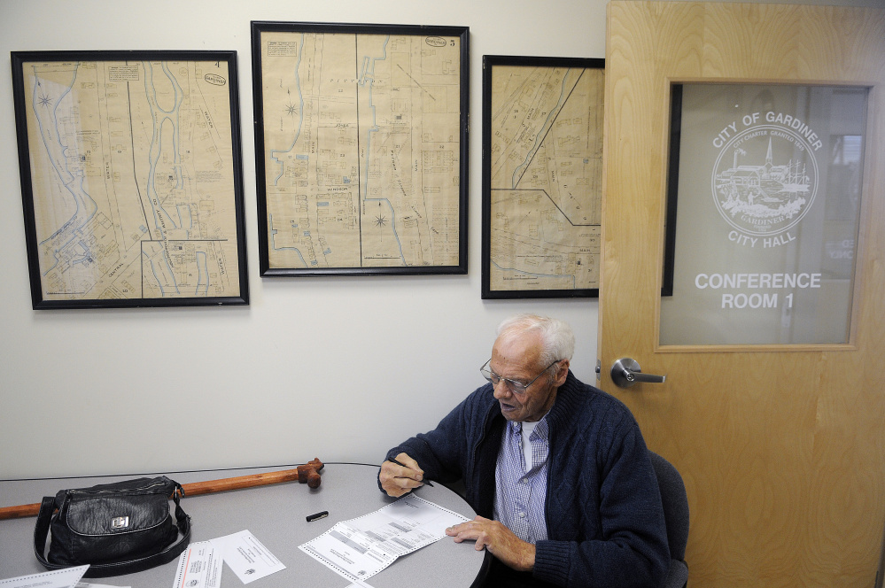 """Ed Pelletier votes Tuesday at Gardiner City Hall, where City Clerk Lisa Gilliam said her office has been """"swamped"""" by early voters."""