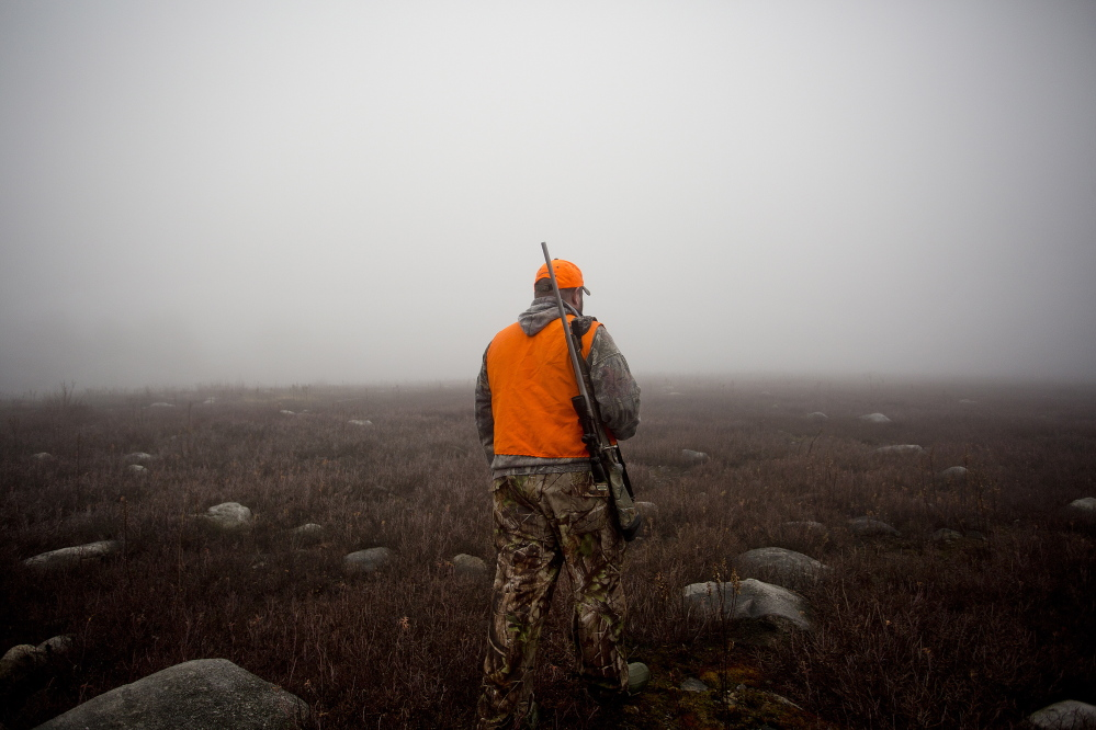 John Vogt Jr., of Oakland, makes his way through dense fog on Nov. 12, 2014, in a blueberry field in New Sharon back toward his truck while hunting moose with his father, John Vogt, of Belgrade. Of the roughly 181,000 people who hunt in Maine each year, about 40,000 come from out of state, spending $102 million on trip-related expenses, according to state data from 2011.