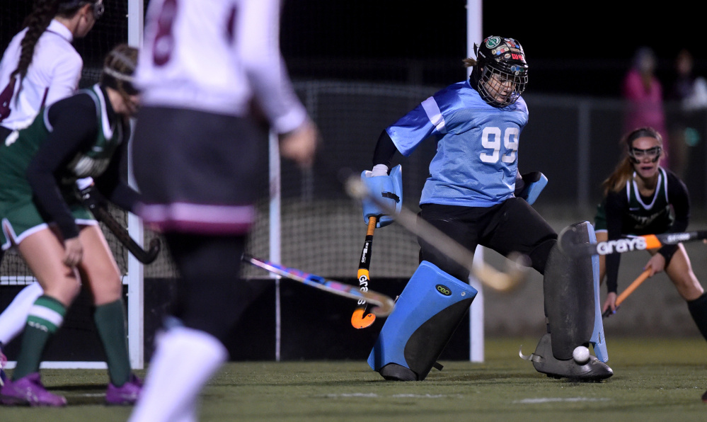 Winthrop goalie Corinna Coulton (99) makes a save against Maine Central Institute in the Class C North final Wednesday in Hampden.