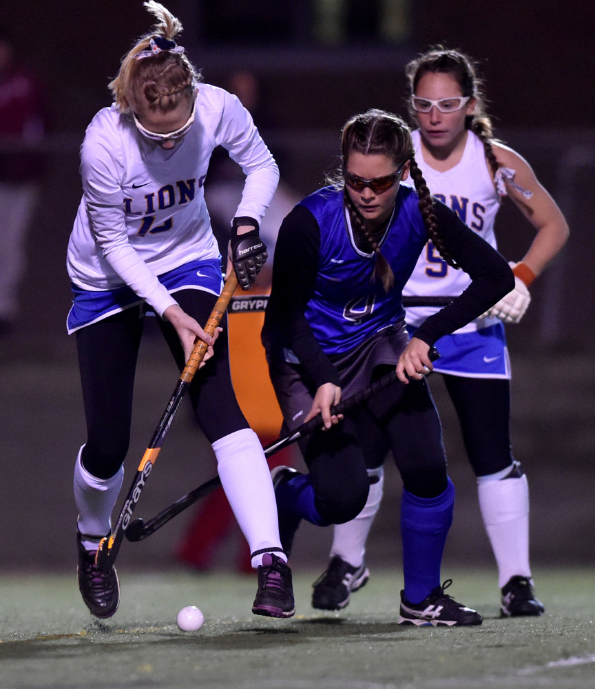 Belfast's Sabrina Wood, left, battles for the ball with Lawrence's Alexis Lewis  during the Class B North final Wednesday night Hampden Academy.
