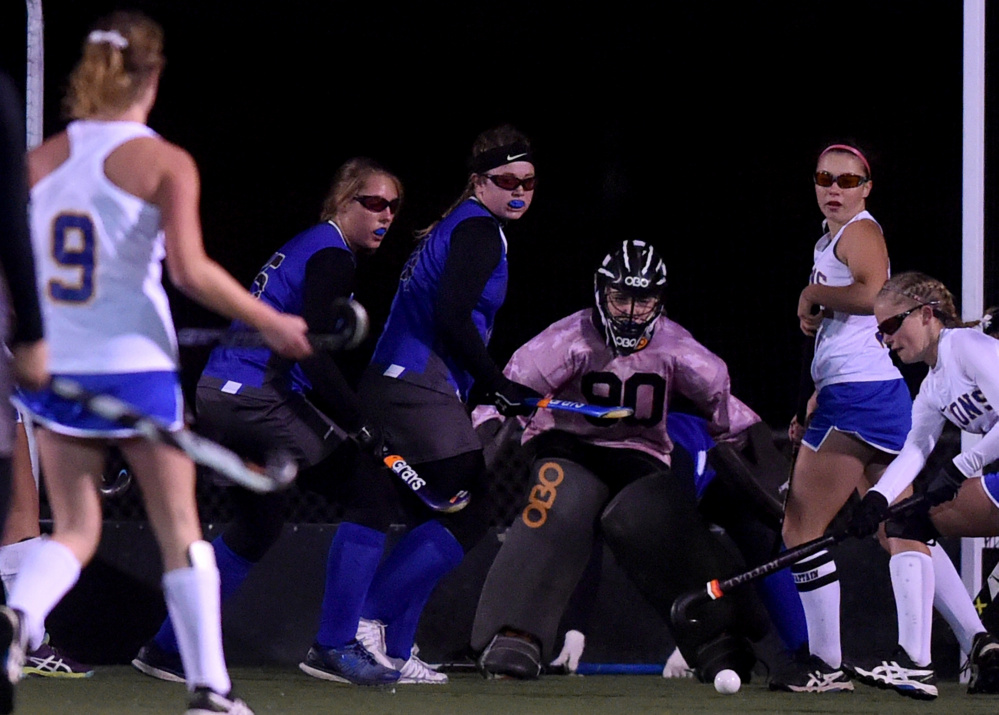Staff photo by Michael G. Seamans Lawrence goalie Marian Zawistowski makes a save during the Class B North final against Belfast on Wednesday night Hampden Academy.