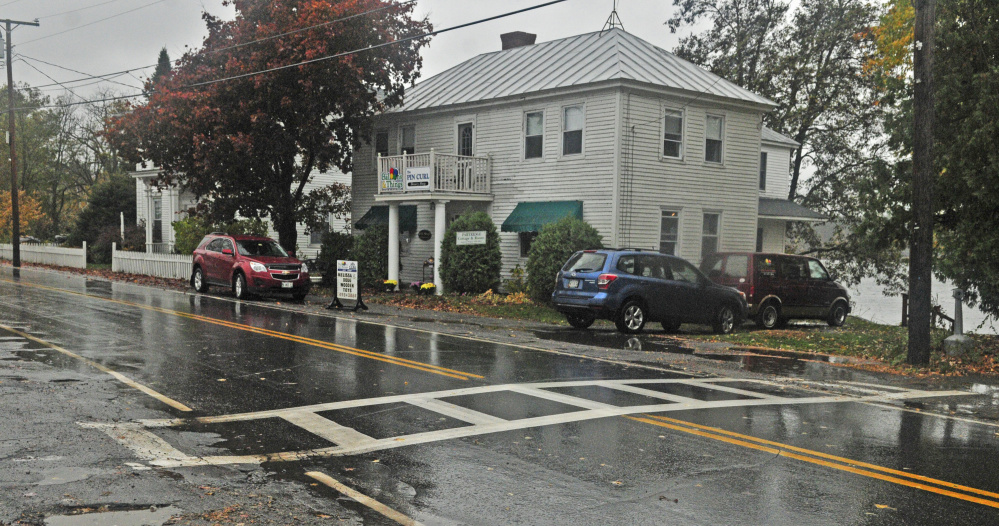 There is a proposal to move a crosswalk, shown in this Friday photo, south from its current location to run between Balloons & Things and Pincurl Beauty Shop, right, and the Maine Lakes Resource Center Annex and the Post Office in Belgrade Lakes village.
