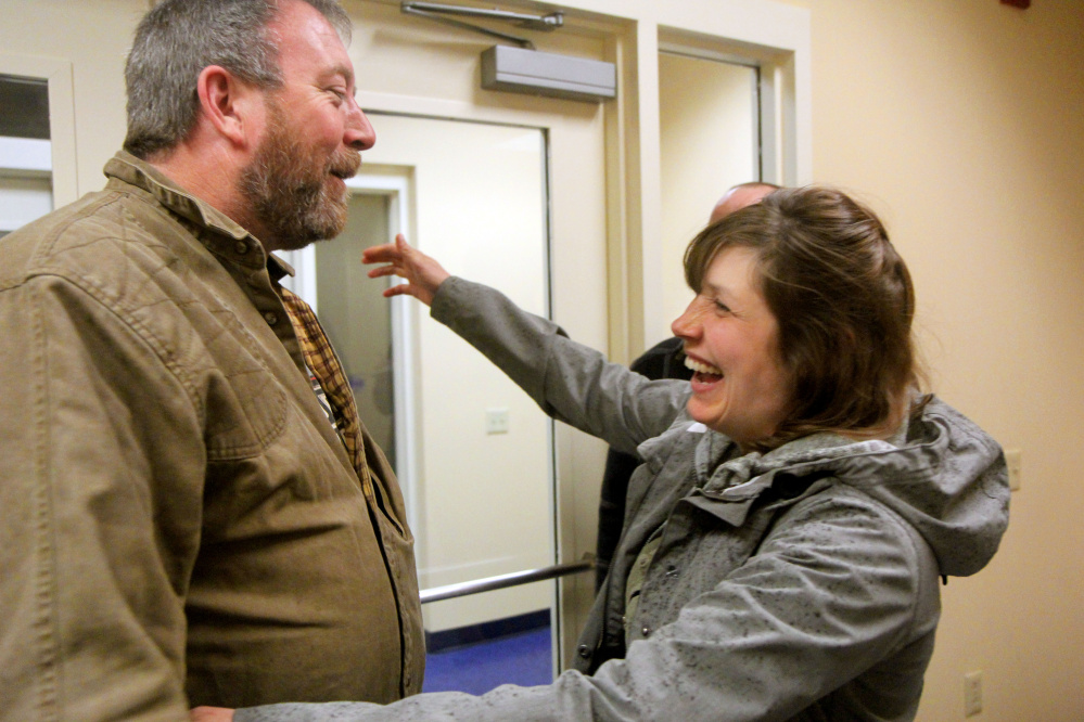 For the first time since her Oct. 10 car accident, Erin Kaye of Durham greets the man she believes saved her life. Truck driver Scott Landon, of Burnham, came to Kaye's aid after she lost control of her car while traveling south to work on Interstate 295 in Falmouth.