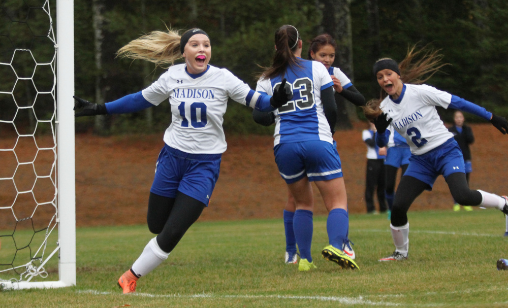 Madison midfielder Madeline Wood celebrates her eventual game-winning goal after beating Sacopee goalie Madison Day off a corner kick from Ashley Emery in the first half of a Class C South soccer semifinal in Madison on Saturday.