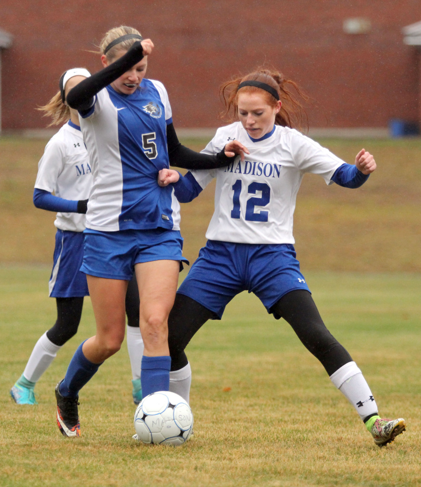 Madison's Ashley Emery tries to take the ball from Sacopee's McKenzie Murphy in the first half of a Class C South girls soccer semifinal in Madison on Saturday. Madison won 1-0.